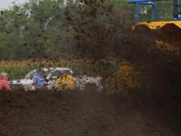 Turning composted manure at the Manure Expo 2016